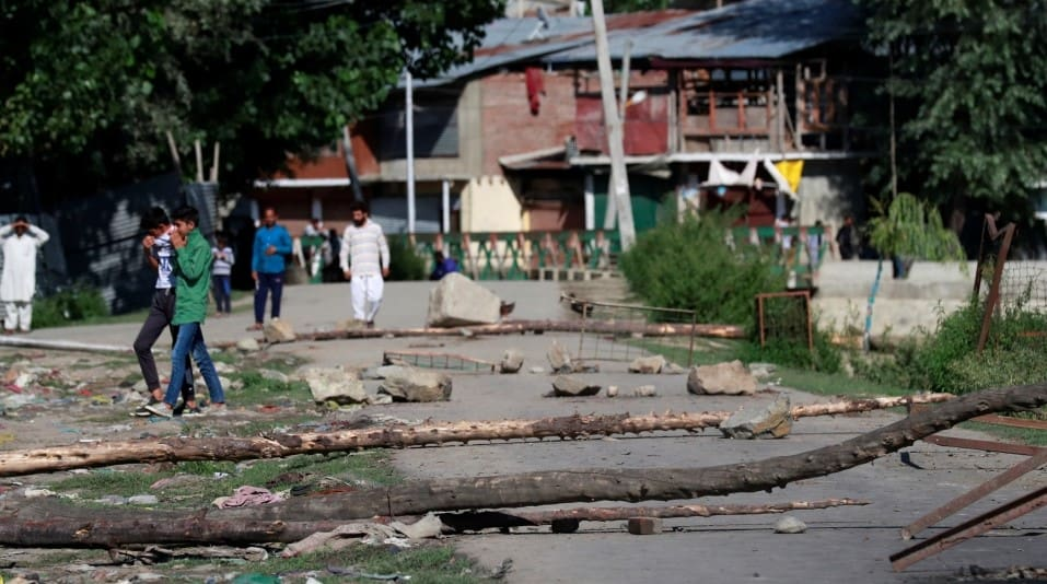 A neighbourhood street is blocked with tree branches by Kashmiri protesters during restrictions in Srinagar